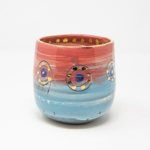 Pink and blue ceramic beaker doted with gold luster