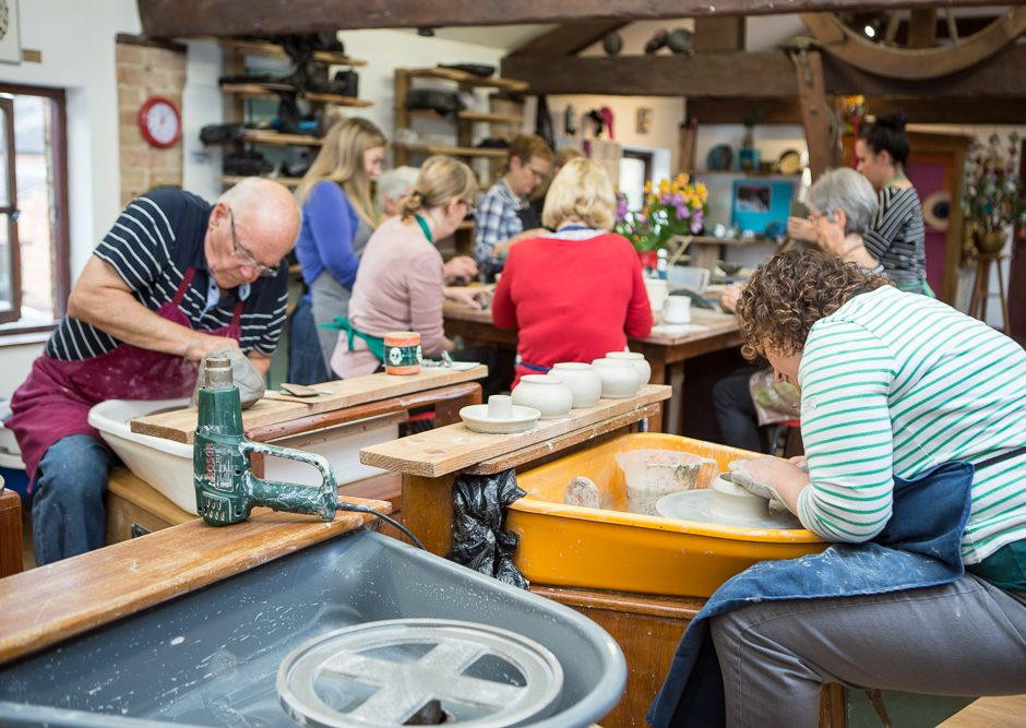 Students on pottery wheels at The Ceramics Studio Ettington