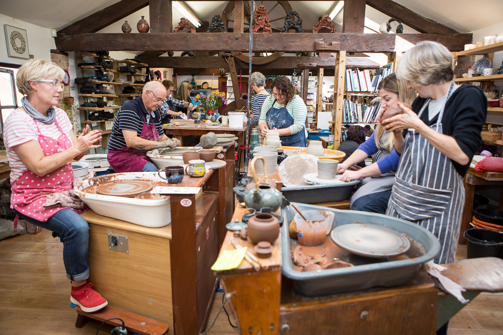 Students on pottery wheels at The Ceramics Studio Ettington