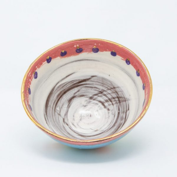 Interior of ceramic bowl painted white, pink and purple