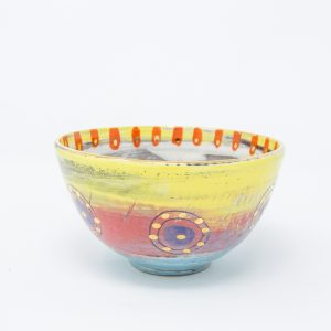 Yellow, pink and blue ceramic bowl with purple circles and dots of gold luster