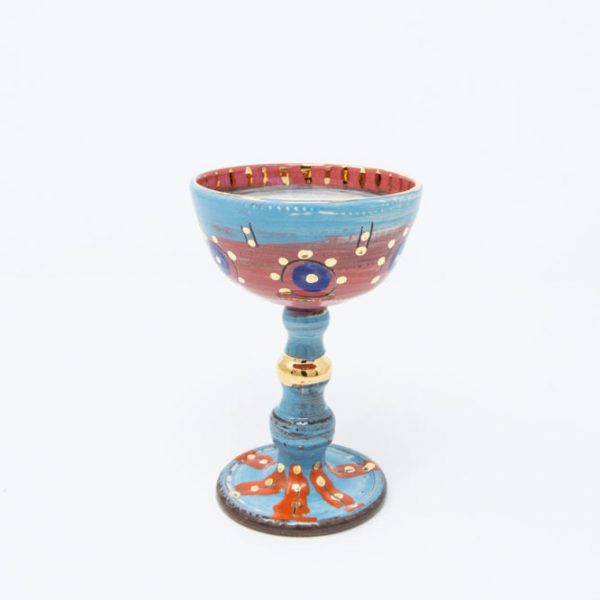 Pink and blue ceramic goblet with purple circles and dots of gold luster