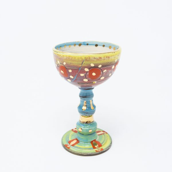 Yellow and pink ceramic goblet with orange circles and dots of gold luster