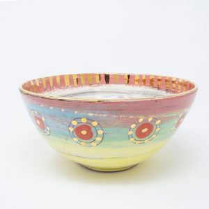Yellow, blue and pink ceramic salad bowl with dots of gold luster