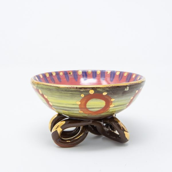 Pink and yellow ceramic soap dish with orange circles and dots of gold luster