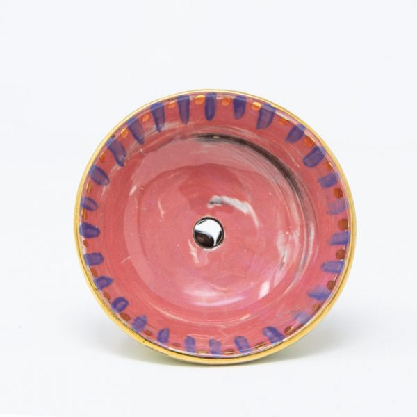 Top view of ceramic soap dish with pink bowl and dot of gold luster in middle