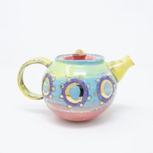 Yellow, blue and pink ceramic teapot with purple circles and dots of gold luster