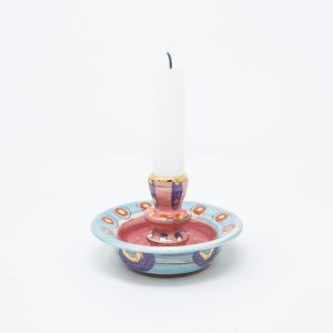 Pink and blue ceramic candle stick with purple circles and dots of gold luster