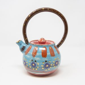 Blue, purple and pink ceramic teapot decorated with stripes and dots of gold luster