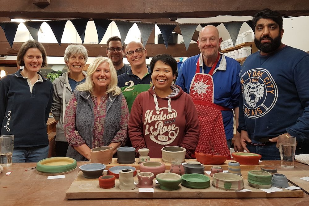 Group of students and their work at the Ceramics Studio