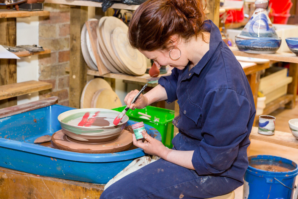 Leyla Folwell painting pottery