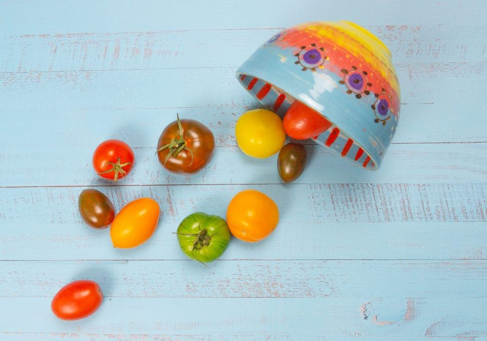 Tomatoes spilling out of small bowl from Leyla Folwell's Colombia range