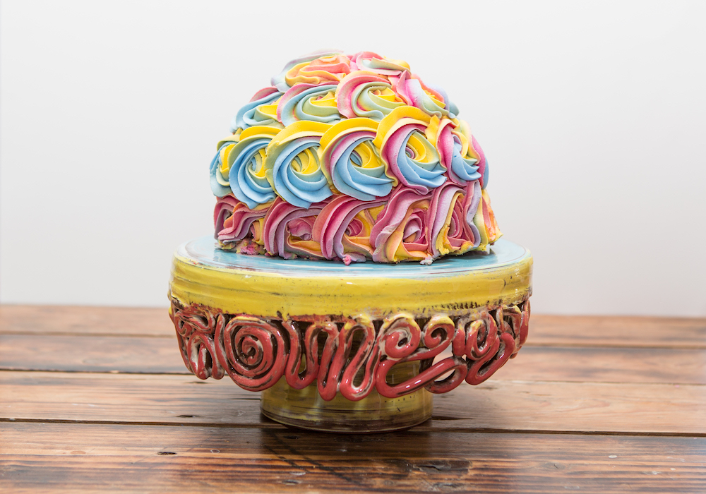 Colourful cake on ceramic cake stand by Leyla Folwell