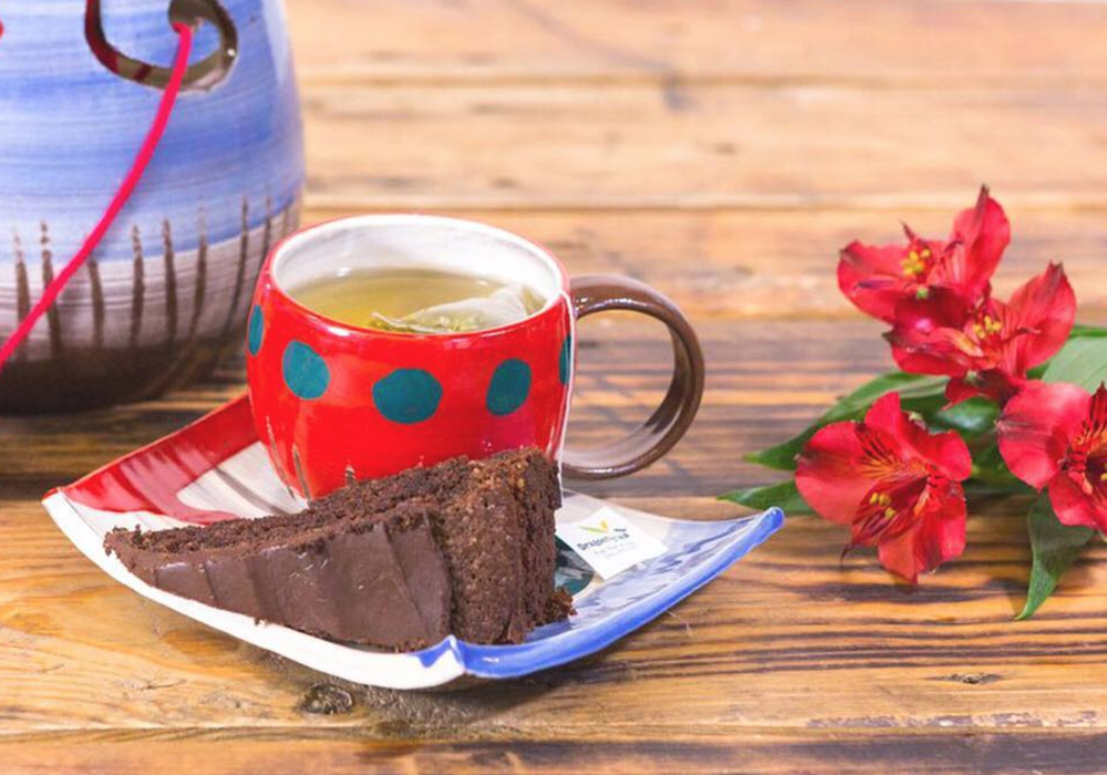 Tea and cake served on handmade ceramic plates